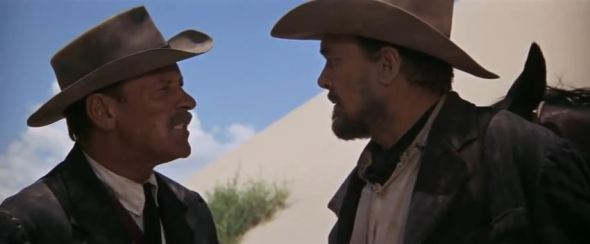 """William Holden and Ben Johnson """"When you side with a man, you stay with him."""""""