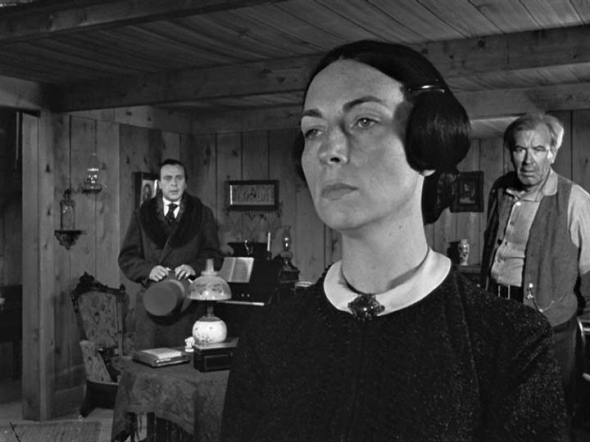 "as Mrs. Kane in ""Citizen Kane"""
